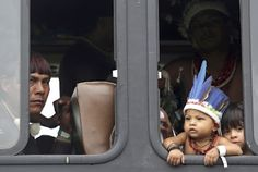 Indigenous people arrive at a meeting by bus during the Rio+20 United Nations Conference on Sustainable Development summit in Rio de Janeiro June 21, 2012.