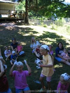 messy party! 1)digging through canisters of flour to find pennies 2)whipping cream pie throw 3)body painting 3)mini pool full of jello/pudding 4) human sundaes 5) bobbing for apples in pudding 6) powder mini donuts on a string 7) pinata water balloons full of slime/pudding 8) face painting 9) silly string 10) spray hair dye