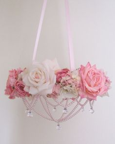 Large Pink Floral Mobile READY TO SHIP by OohLaLaBabe on Etsy, $115.00/ it is a foam ring wrapped in pink ribbon, pearl garland is glued underneath flwers onto form. have to arrange while it's hanging. looks like crystal pendants shaped like bureau pulls/knobs