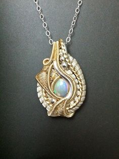 intricate wire wrap fashion statement, heady wire wrap opal in silver and 14k gold filled