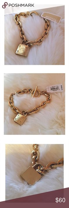 Chainlink bracelet | Michael Kors Michael Kors padlock chainlink bracelet. This is SO gorgeous and perfect for layering with other bracelets!  ❥ Gold ❥ Tag included   This was worn only once. It is practically new. The only signs of wear are a few small scratches on both the face and the back of the padlock. They are not at all noticeable unless you look for them in certain light. Michael Kors Jewelry Bracelets