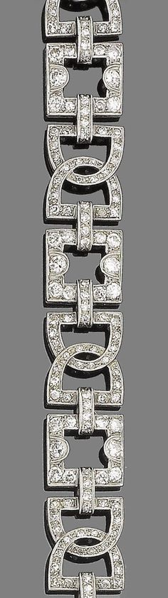 An art deco diamond bracelet, circa 1920.  The continuous row of openwork plaques of geometric design, set throughout with old brilliant, brilliant, single and rose-cut diamonds, old brilliant, brilliant and single-cut diamonds approx. 4.65cts total, two paste replacements, length 18.8cm