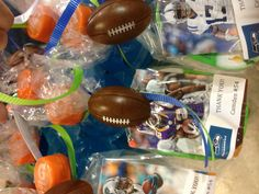 Football party favor.  Sports drink with a box of Pringles and a football card tied on.