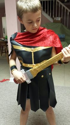 Gladiator costume i made from duct tape and t shirts duct tape gladiator costume of black vinyl trimmed in gold duct tape the material cuts easily and solutioingenieria Gallery