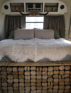 What an inventive idea for a footboard in an RV or Travel Trailer.  I love the warm and rustic decor in this bedroom on wheels:)