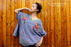Batik Amarillis's Breezy top in spectacular Hungarian embroidery inspired style  on chambray & batik   .. it's Freesize , super cool,comfy ,sexy and swirling outfit with criss-cross back detail for you to enjoy and wear!!! Available at Batik Amarillis webstore www.batikamarilli...