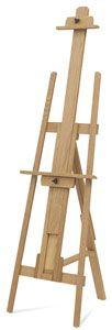 """A-frame easels are easels with 3 legs – 2 in front and 1 in back, triangular in silhouette. Then are called """"A"""" frame because from the center front the structure resembles the letter """"A"""". The Tripod design allows for a sturdy foundation for painting and this shape is easy to setup in corners or tight spaces. Most models rear legs flatten for convenient storage."""