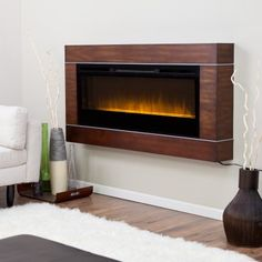 So beautiful it doubles as a piece of art, the Dimplex Cohesion Wall-Mount Fireplace adds flickering firelight and a romantic, relaxed ambience to any room in the house. Wall Mounted Electric Fires, Fireplace Wall, Modern Fireplaces, Wall Design, Family Room, Living Room, House, Future, Decor Ideas