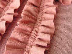 Double Stitch Finishing: Double Needle securing of gathered ruffle -this would work well on onesie  diaper cover ruffles.
