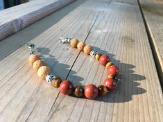 This uniquely handcrafted, Tigers Eye and Carnelian stone lava bracelet from Mystically Charmed, a division of Simply Charmed Jewelry has lots going for it. It's two types of Semi Precious Stones work good together. It's held together with stainless steel wire and all nickel free too. It measures Handmade Bracelets, Handcrafted Jewelry, Beaded Bracelets, True Gift, Lava Bracelet, Sparkly Jewelry, Healing Bracelets, Stone Work, Jewelry Making