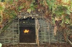 Image result for side of hill survival shelters in the woods