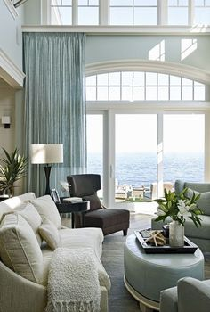 Soft ocean colours enhance this space and help connect it to the view through the vast expanse of glass windows. A wonderful, idyllic space.