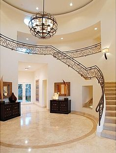 """The house in Calabasas, California, where Nick Lachey and Jessica Simpson lived while filming their reality show """"Newlyweds"""" is on the market. House Staircase, Staircase Design, Jessica Simpson Nick Lachey, Nick And Jessica, Beautiful Stairs, Property Design, Foyer Decorating, Celebrity Houses, Elegant Homes"""