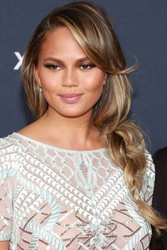 """Who: Chrissy Teigen What: A Loose Braid Guy's Opinion: """"This is sexy because it makes me think of laid-back surfer girls, the kind you would quit your job and run away to a beach town for."""""""