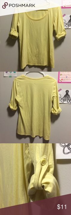 Light yellow top Simple top with rolled up and buttoned sleeves. Thin line of chiffon pining the neckline front and back. From New York and company, never worn. New York & Company Tops Blouses
