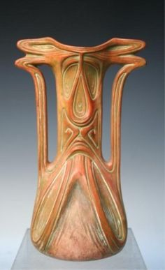 "VIENNESE SECESSIONIST vase by Julius Dressler, Austria, circa 1900; marked on bottom. The handles and rim appear to be a stylized dragonfly; the bottom half a stylized cicada. Dimensions: 8-1/2""H x 5-1/4""W x 4-1/8"" diameter"