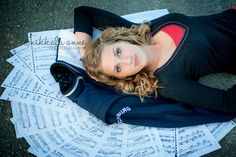 nikkalaannephotography.com  senior girl photo session laying on music and jacket