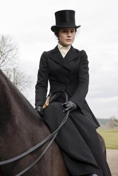 Even in 1913 the upper class dressed by strict rules for each time of day and each activity. Mary is allowed to go on the hunt, but is constrained by a long skirt and sidesaddle. She does, however, look properly elegant in her hat and veil.