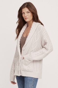Our Rowan cardigan is all things effortless and cozy. Knit pattern detailing throughout give this cardi a unique touch. Accented with a relaxed silhouette, shawl collar, V-neck, button-front closure and patch pockets.