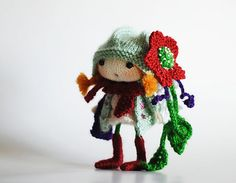 Ravelry: Floret. The Small Doll. She has a mouth with tongue. Wire in the lags pattern by Tetyana Korobkova