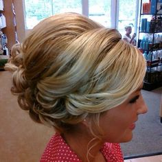 Cute teased blonde up-do. Great for weddings, prom, or a special night out.