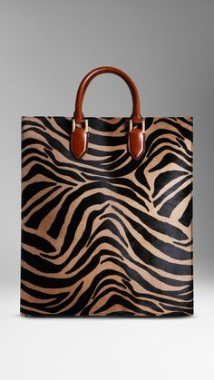 Burberry - Striped Animal Print Tote bag in striped animal print, calfskin with leather trim. Animal Print Tote Bags, Printed Tote Bags, Animal Prints, Animal Print Shop, Animal Print Fashion, Fashion Handbags, Purses And Handbags, Fashion Bags, Burberry Tote Bag