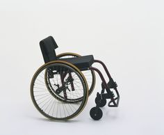 "SAVE Champion 3000 Adjustable Rigid-Frame Wheelchair Rainer Küschall (Swiss, born 1947)  1986. Aluminum, rubber, plastic, and nylon, 31 x 24 x 34"" (78.8 x 61 x 86.3 cm), seat h. 22"" (55.9 cm). Manufactured by Küschall of America, Camarillo, CA. Gift of the manufacturer 146.1988"
