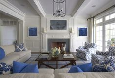 A clean, symetrical design by Lynn Morgan makes use of a strict blue-and-neutral-linen colour scheme, in this ample living room.