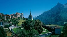 Gruyères - Castle and Small Town - A picture-perfect medieval town on a small hill with a castle and three totally different museums: In Gruyères, 800-year-old regional history and culture meet Oscar-winning aliens and Buddhist sculptures.
