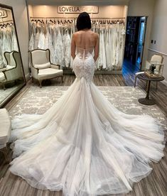 How dreamy is the train on this gown? We're so obsessed!