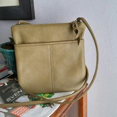 Cross Body Olive Green Bag Olive green, leather bag with a front pocket and zipped pocket on the opposite side. Inner fabric can be wiped clean. Perfect for a large cell phone and other essentials. Made in Berkeley, USA. Sven Bags Crossbody Bags