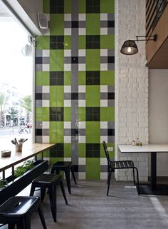 Avanti Restaurant in Tel Aviv by OPA. green grey and black patterned tile decorated the wall near the window