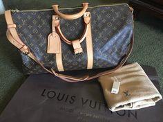 Louis Vuitton Keepall 50 Bandoulier 50 Travel Bag.