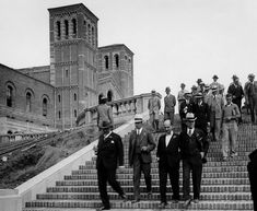 (1929) - Opening Day at the new UCLA campus in Westwood. A group of men are shown walking down Janss Steps, constructed in 1928-29 and designed by architect George W. Kelham. A partial view of Royce Hall may be seen on the left.
