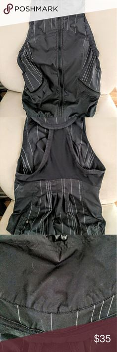 Luluemon yoga vest Zip front vest with  racer back & pleated detail in back. Light pinstripe accents, toggle to loosen neck. Sz 8 M. In great pre owned condition. lululemon athletica Tops