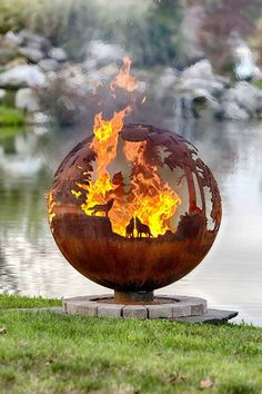 These fire pit ideas and designs will transform your backyard. Check out this list propane fire pit, gas fire pit, fire pit table and lowes fire pit of ways to update your outdoor fire pit ! Find 30 inspiring diy fire pit design ideas in this article. Fire Pit Sphere, Metal Fire Pit, Diy Fire Pit, Fire Pit Backyard, Fire Pits, Fire Pit Globe, Fire Pit Art, Large Backyard, Fire Pit Gallery