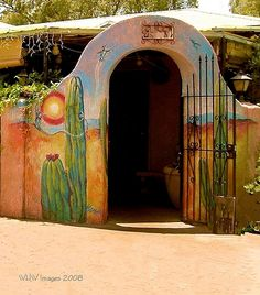 Tucson Flavor, painted adobe - I've been wanting to paint my patio wall, I may take my cue from this art. :)