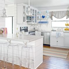 While no gutting took place during the renovation of this cottage kitchen, the L-shape space did get a much-needed face-lift. A fresh coat of paint, shiplap paneling on the walls and island, new concrete countertops, and a sparkling white backsplash brought fresh, new life to the once-drab kitchen.