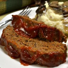 """""""The secrets to this meatloaf are fresh, very finely diced vegetables that give it moisture and flavor -- and a light touch in mixing together the ingredients. This hearty meatloaf is the perfect meal for cool fall and winter evenings, served with ma Sweetie Pies Recipes, Meat Recipes, Food Processor Recipes, Cooking Recipes, Dinner Recipes, Dinner Ideas, Cooking Time, Vitamix Recipes, Jelly Recipes"""