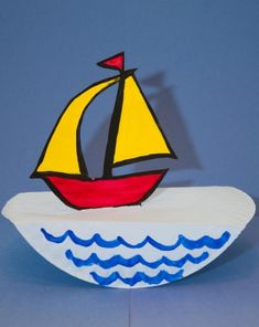 Bring a swell of high sea adventure to your own living room with this quick and easy paper sailboat craft!