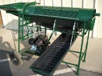 You won't forget the name of this heavy duty piece of gold prospecting equipment -- it really is a Big Green Trommel -- ready to handle your big loads of dirt and gravel!  Its fine gold recovery sluice box makes this unit a gold getting machine!  http://www.goldrushtradingpost.com/big_green_trommel
