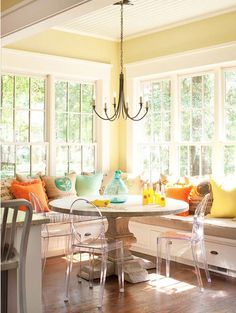 Nice combination of pieces we see frequently. But used together in this bright sunny spot, with the citrus colored pillows...a pretty cheerful way to start the day!