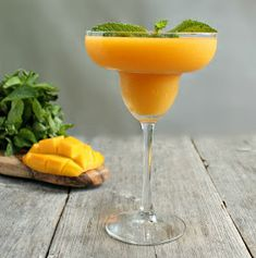 You can shake your Mango Daiquiri& but it is commonplace to blend them with ice also. Blending the daiquiri gives it a smoother texture and perfect for a hot summers day! Mango Cocktail, Daiquiri Cocktail, Mango Rum, Mango Margarita, Cocktail Glass, Cocktail Shaker, Cocktail Drinks, Smoothies, Frozen Cocktails