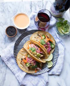 Korean Chicken Tacos topped with an Asian Slaw paired with Liberated Pinot Noir wine. #recipe