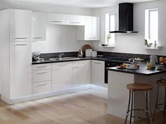 White Wall Mounted Cabinet Kitchens With Black Appliances And White Cabinets White L Shaped Cabinets Yellow Island Pendant White Stone Backsplash