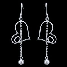 Silver earrings, heart Silver earrings, Ag 925/1000 - sterling silver. Dangle earrings. Rhodium-plated. Fancy heart-shaped earrings decorated with chain ended by bead with approx. 5mm diameter. Dimensions approx. 40x19x1mm excluding enclosure. Price per pair.