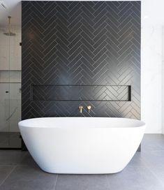 Bathrooms with Black Herringbone Tiles and white freestanding bathtub @turboconstructionau | Black and white bathrooms #bathroomtiles
