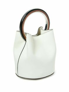 New-season collection is loaded with geometric details, and this white leather bag is a fresh illustration. It has an unlined shape that secures with a press-stud fastening. Fashion Handbags, Purses And Handbags, Fashion Bags, Leather Handbags, Leather Bag, Fashion Jewelry, Beautiful Handbags, Beautiful Bags, Bucket Bag
