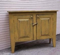 """This Sideboard Cabinet Cupboard will be a great addition to your country rustic or primitive decor.    This handcrafted sideboard comes with a door and shelves on the inside for extra storage.    Measures approximately 32"""" H x 42"""" W x 12"""" D."""