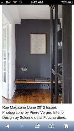 Love this dark grey wall color.